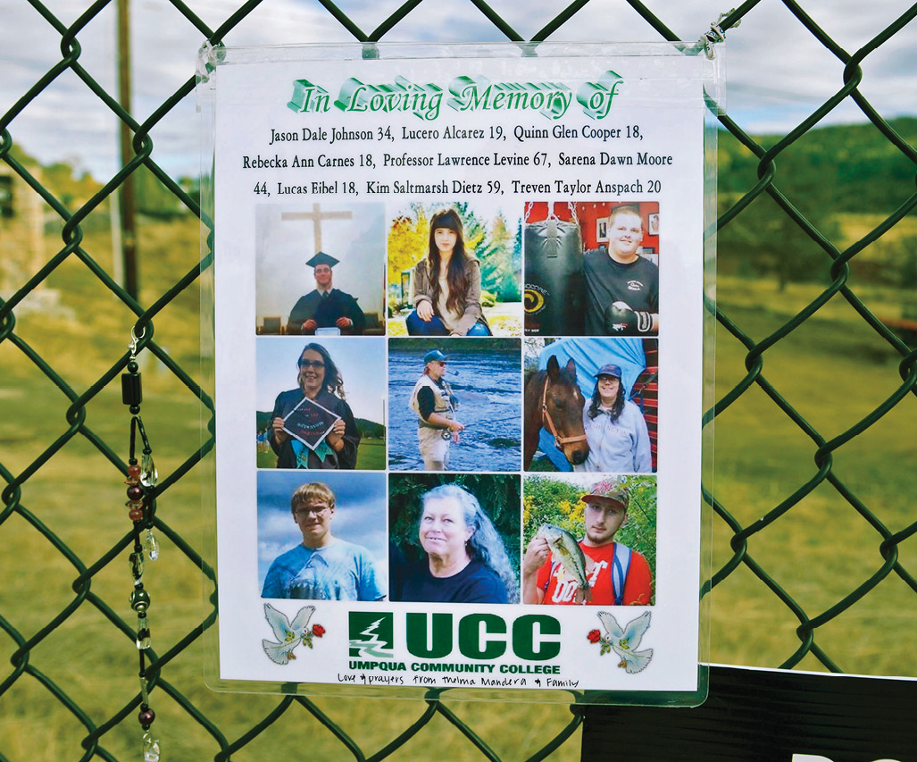 In Loving memory poster hangs on a fence near Umpqua Community College where nine people were killed in a campus shooting