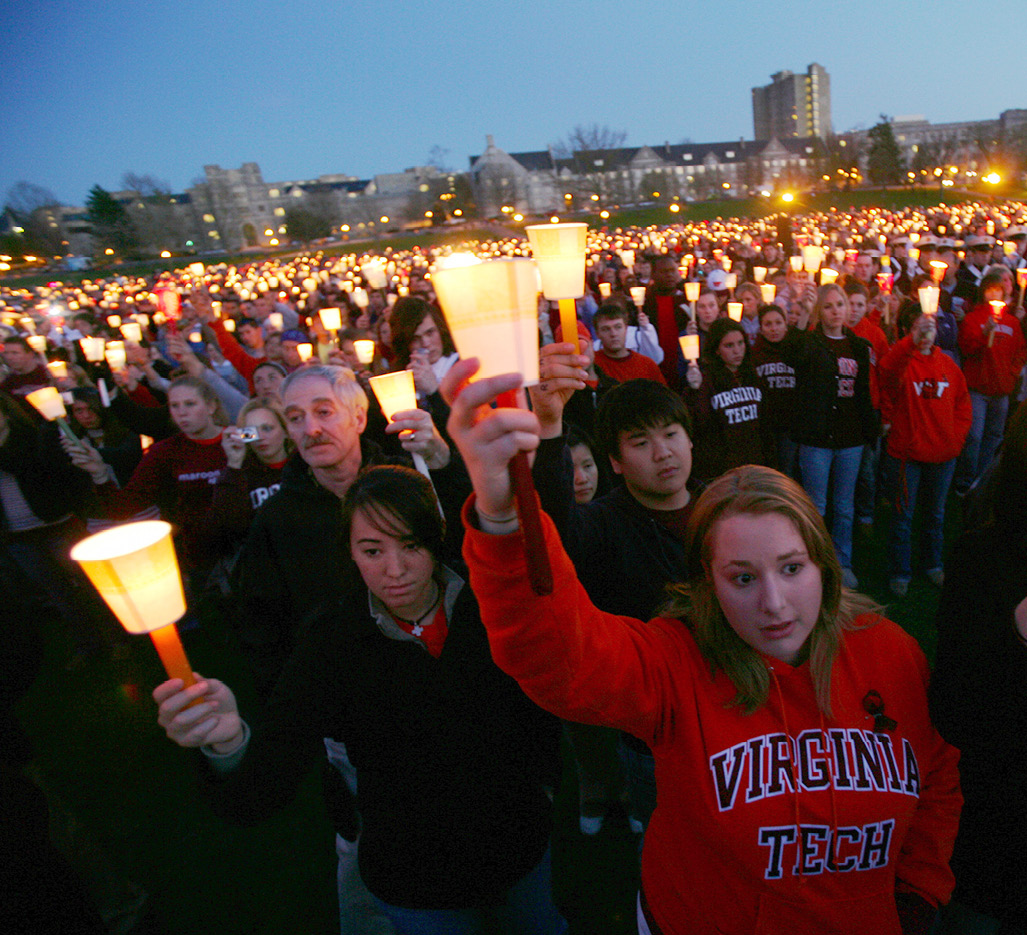 Students and other members of the campus community gather for a vigil at Virginia Tech University