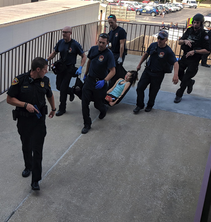 Missouri State student is carried out on a makeshift stretcher during an active shooter training exercise