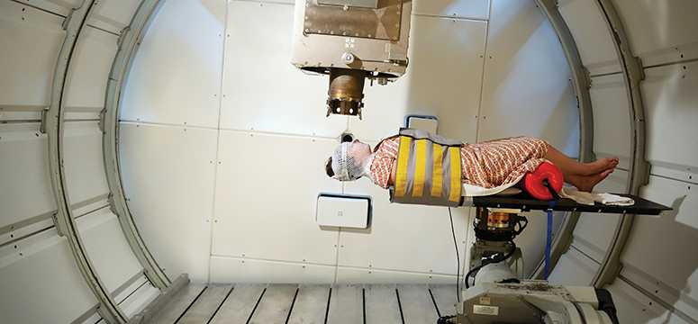 A patient undergoes treatment in a proton therapy facility.