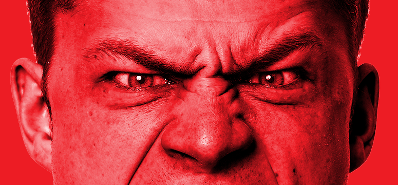 Close photo of an angry man with a red overlay