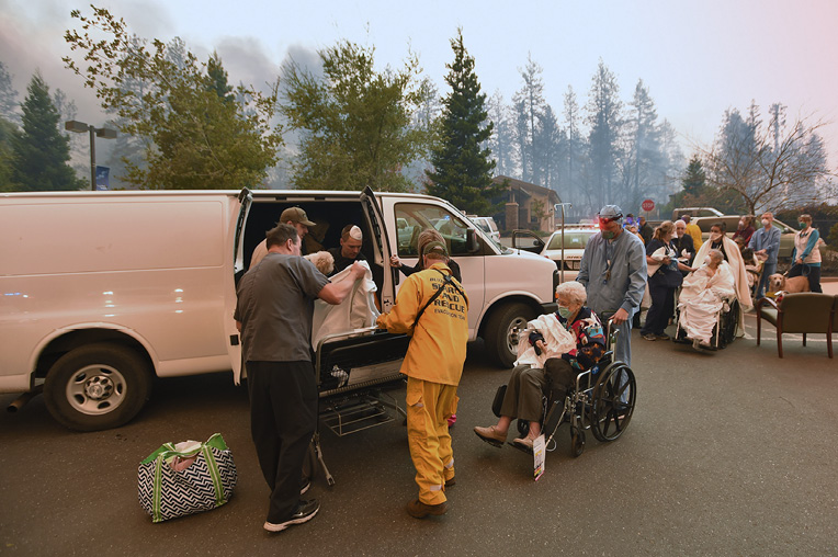 Search and rescue teams assist with the evacuation of the Feather River Hospital.