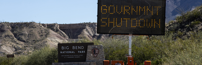 Outside of the entrance of the Big Bend National Park is a sign that says Government Shutdown