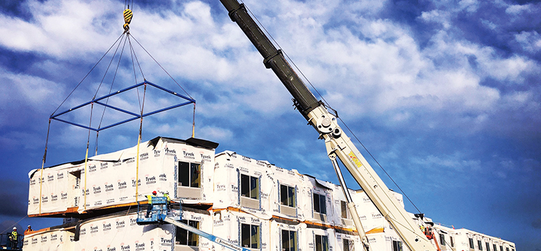 Crane placing a modular building together