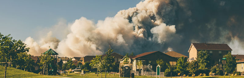 Wildfire surrounding some homes