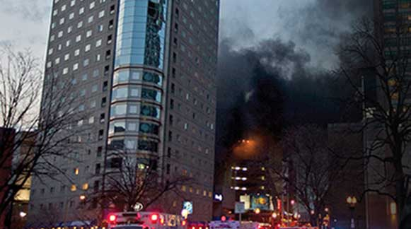 Fire burns a tall building