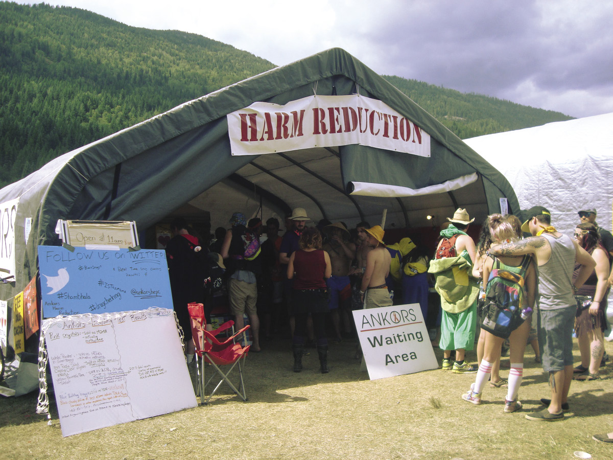 A line forms at the Harm Reduction Tent