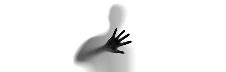 Silhouette of a man reaching out with a hand.