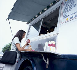 woman getting something to eat at a food truck